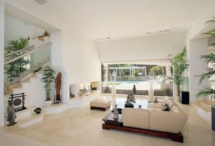Asian Living Room with High ceiling, Sunken living room, terracotta tile floors, specialty door, Avocado leather ottoman