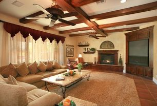 Craftsman Living Room with Ceiling fan, insert fireplace, Exposed beam, terracotta tile floors, Fireplace, can lights