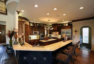 Traditional Kitchen with Breakfast bar, specialty door, Pendant light, can lights, Simple granite counters, Crown molding