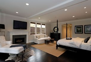 Traditional Master Bedroom with Cement fireplace, Crown molding, Casement, Exposed beam, Hardwood floors, Fireplace