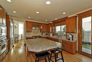 Traditional Kitchen with Wall Hood, Paint 1, Undermount sink, single dishwasher, Glass panel door, Hardwood floors, gas range