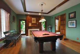 Craftsman Game Room with Hardwood floors, Pendant light, Cement fireplace, French doors