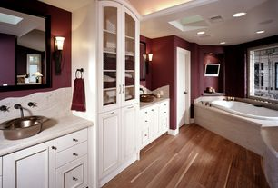 Eclectic Master Bathroom with soapstone tile counters, Hardwood floors, Arizona tile silver beige vein cut limestone, Flush