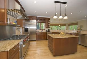 Traditional Kitchen with Traditional Ferro Scroll Bronze Triple Multi Light Pendant, Stone Tile, full backsplash, gas range