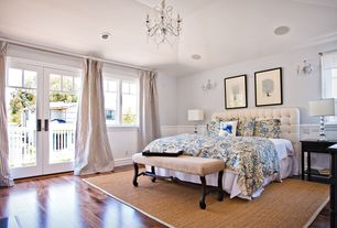 Traditional Guest Bedroom with Wainscotting, specialty window, Wall sconce, Chandelier, Standard height, French doors, Carpet