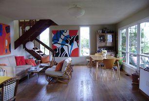 Eclectic Great Room with Mural, Hardwood floors, Sunken living room, Molded walnut side chair