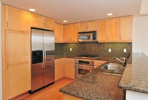 Traditional Kitchen with Simple granite counters, Flat panel cabinets, Galley, Frameless, Undermount sink, Hardwood floors