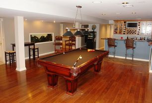 Traditional Game Room with Columns, flush light, Hardwood floors