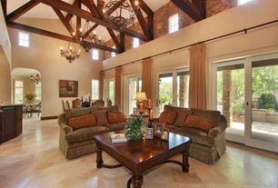 Eclectic Living Room with Exposed beam, Chandelier, French doors, travertine floors, Cathedral ceiling