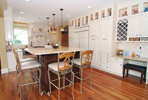 Traditional Kitchen with warming oven, electric cooktop, Standard height, Custom hood, Undermount sink, Subway Tile, U-shaped