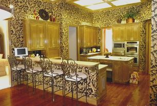 Eclectic Kitchen with Skylight, Formica counters, Undermount sink, Crown molding, Kitchen peninsula, Breakfast bar, U-shaped