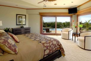 Tropical Guest Bedroom with Ceiling fan, Carpet
