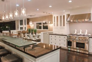 Contemporary Kitchen with Bella pendant in crystal, Breakfast bar, Hardwood floors, Undermount sink, Chandelier, Stone Tile