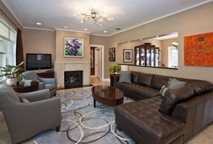 Eclectic Living Room with Standard height, insert fireplace, Casement, Crown molding, Fireplace, Chandelier, can lights