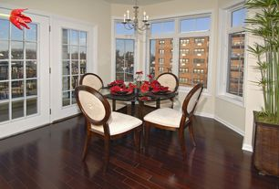 Modern Dining Room with French doors, High ceiling, Hardwood floors, Casement, Transom window, Chandelier