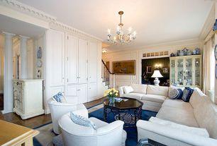 Traditional Living Room with Chandelier, Laminate floors, Standard height, Carpet, Built-in bookshelf