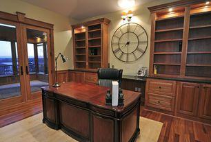 Traditional Home Office with Built-in bookshelf, Hardwood floors, Glass panel door