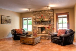 Rustic Living Room with Paint, Casement, AUTUMN COMFORT ALDER WOOD COFFEE TABLE, stone fireplace, terracotta tile floors