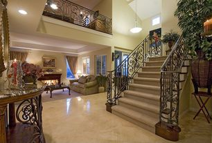 Mediterranean Staircase with Cathedral ceiling, Pendant light, Floating staircase, Loft