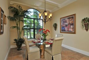Traditional Dining Room with Concrete tile , Arched window, Crown molding, Exposed beam, Chandelier