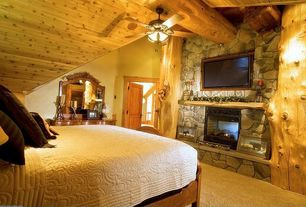 Rustic Guest Bedroom with Fireplace, Ceiling fan, Carpet, stone fireplace, flush light, Standard height, six panel door