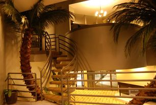 Modern Staircase with curved staircase, High ceiling, Indoor plant, Concrete floors, Loft, Chandelier