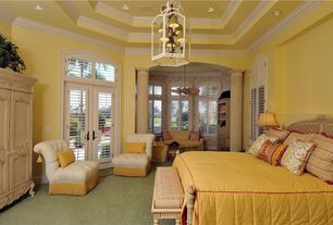 Traditional Master Bedroom with High ceiling, Carpet, Transom window, Box ceiling, French doors, Crown molding, Columns