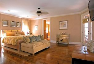 Traditional Guest Bedroom with Ceiling fan, Hardwood floors, Crown molding, Built-in bookshelf, French doors