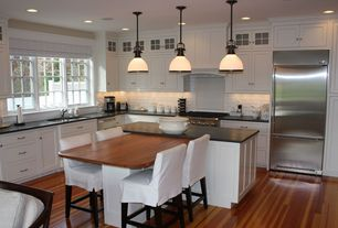 Traditional Kitchen with Glass panel, Undermount sink, Soapstone counters, Breakfast bar, Glass Tile, Flat panel cabinets