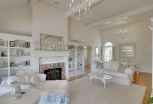 Traditional Living Room with Arched window, Carpet, Pottery Barn Bevel Rectangular Mirror, Built-in bookshelf, High ceiling