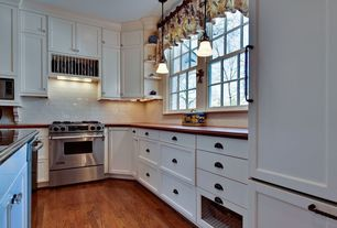 Cottage Kitchen with Stone Tile, Pendant light, Jeffrey alexander 8233orb lyon shaker cup pull, Galley, Copper counters