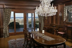 Traditional Dining Room with High ceiling, French doors, Glass panel door, Wall sconce, Bamboo floors, Chair rail, Carpet