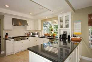 Traditional Kitchen with Undermount sink, Flat panel cabinets, Glass panel, Standard height, full backsplash, can lights