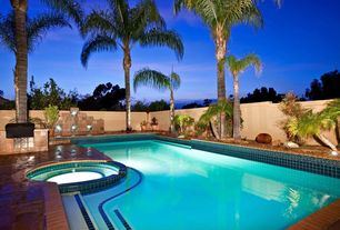 Modern Swimming Pool with exterior terracotta tile floors, Fence, Pool with hot tub, exterior tile floors, Outdoor kitchen