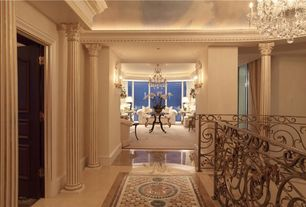 Traditional Hallway with Standard height, Chandelier, Crown molding, Columns, picture window, six panel door