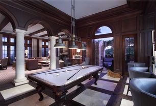 Traditional Game Room with Kasala palermo leather chair, French doors, Bronze 3 light island pendant light fixture, Columns