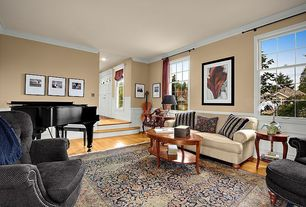 Traditional Living Room with Crown molding, double-hung window, Wainscotting, Standard height, Sunken living room