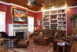 Country Living Room with terracotta tile floors, Ceiling fan, Crown molding, Cement fireplace, Carpet, Built-in bookshelf