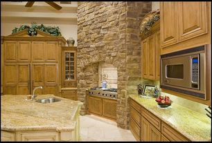 Rustic Kitchen with High ceiling, Simple granite counters, Large Ceramic Tile, Ceiling fan, Kitchen island, Glass panel