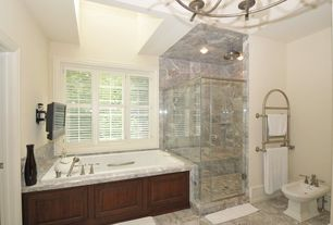 Traditional 3/4 Bathroom with stone tile floors, Bathtub, Paint, Chandelier, Casement, Standard height, drop in bathtub