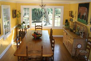 Country Dining Room with Chandelier, Chair rail, Crown molding, Hardwood floors