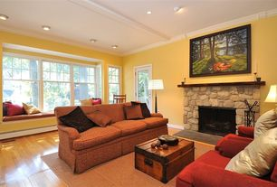 Eclectic Living Room with Hammary hidden treasures coffee table, Crown molding, Window seat, French doors, Hardwood floors