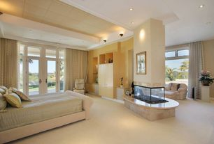 Modern Master Bedroom with Transom window, other fireplace, French doors, Paint 2, can lights, Carpet, Fireplace, Paint