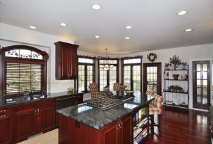 Country Kitchen with single dishwasher, Kitchen island, Breakfast nook, specialty window, Glass panel door, can lights