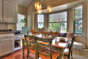 Country Dining Room with Hardwood floors, Bay window, flush light, High ceiling, double-hung window, Window seat