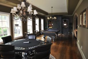 Traditional Game Room with Crown molding, Laminate floors, Chandelier