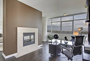 Modern Home Office with Hardwood floors, Fireplace, Standard height, Cement fireplace, can lights, Columns, Paint