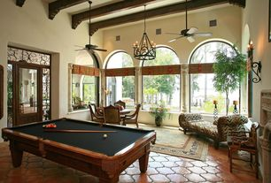 Mediterranean Game Room with Ceiling fan, Aramith Super Pro Value Ball Pak, Exposed beam, Regency Chaise Lounge, French doors