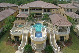 Mediterranean Exterior of Home with Fence, French doors, exterior stone floors, Deck Railing, Pathway, picture window