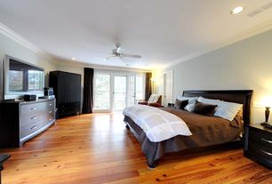 Modern Guest Bedroom with Ceiling fan, French doors, Hardwood floors, Balcony, Crown molding